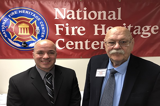 Chris Baker (left) with National Fire Heritage Center Founding President, Chief Ronny J. Coleman (right). (author photo)